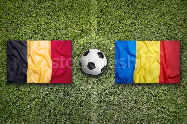 Belçika vs Romanya bayraklar futbol sahası yeşil Stok fotoğraf © kb-photodesign