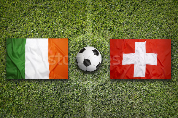 Ireland vs. Switzerland flags on soccer field Stock photo © kb-photodesign