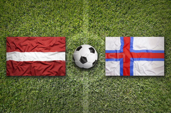 Eilanden vlaggen voetbalveld groene team bal Stockfoto © kb-photodesign