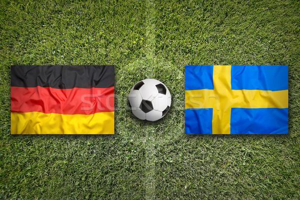 Germany vs. Sweden flags on soccer field Stock photo © kb-photodesign