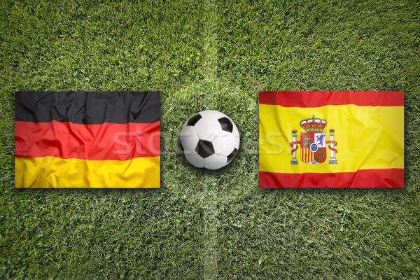 Németország vs Spanyolország zászlók futballpálya zöld Stock fotó © kb-photodesign