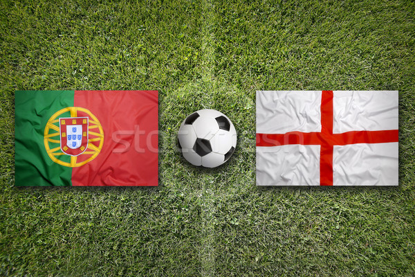 Portugal vs. England flags on soccer field Stock photo © kb-photodesign
