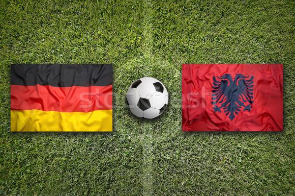 Alemania vs Albania banderas campo de fútbol verde Foto stock © kb-photodesign
