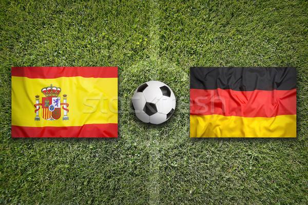 Spain vs. Germany flags on soccer field Stock photo © kb-photodesign