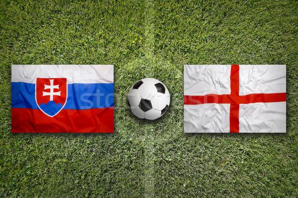 Slovakya vs İngiltere bayraklar futbol sahası yeşil Stok fotoğraf © kb-photodesign