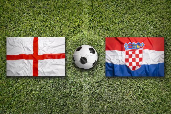 Engeland vs Kroatië vlaggen voetbalveld groene Stockfoto © kb-photodesign