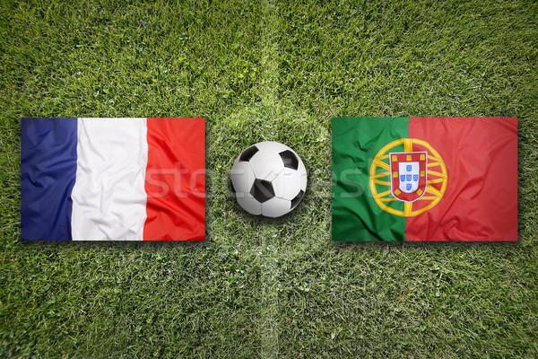 France vs Portugal drapeaux terrain de football vert Photo stock © kb-photodesign