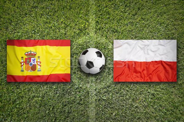 Spanyolország vs Lengyelország zászlók futballpálya zöld Stock fotó © kb-photodesign