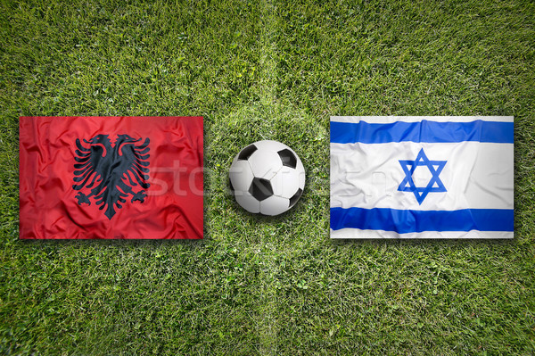 Albania vs. Israel flags on soccer field Stock photo © kb-photodesign