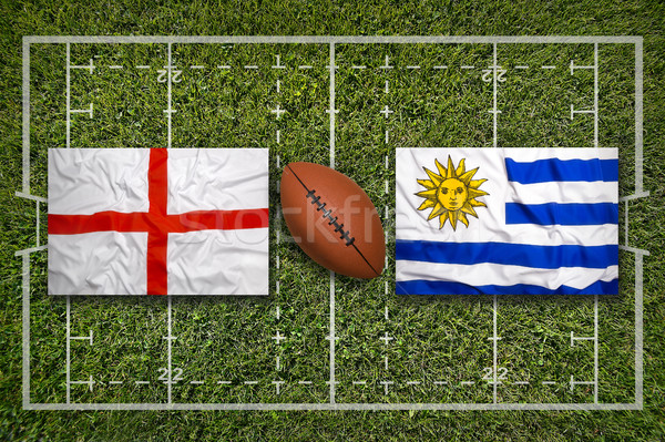 Stock photo: England vs. Uruguay flags on rugby field