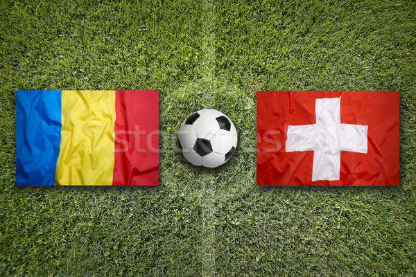 Rumania vs Suiza banderas campo de fútbol verde Foto stock © kb-photodesign