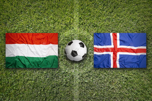Hungary vs. Iceland flags on soccer field Stock photo © kb-photodesign