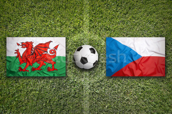Wales vs. Czech Republic flags on soccer field Stock photo © kb-photodesign