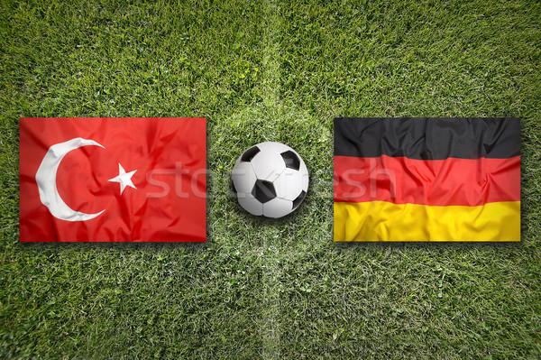 Törökország vs Németország zászlók futballpálya zöld Stock fotó © kb-photodesign
