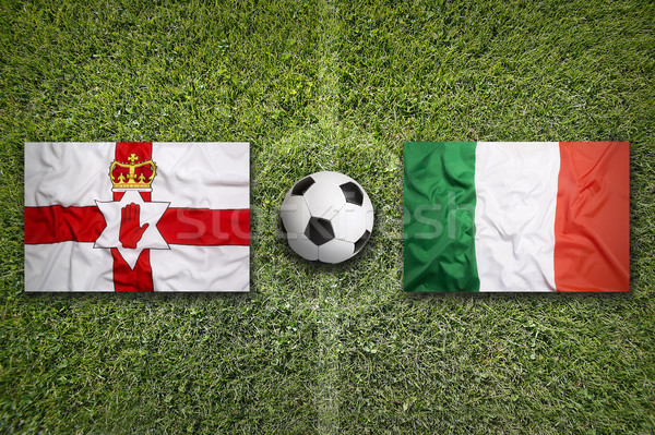 Northern Ireland vs. Italy flags on soccer field Stock photo © kb-photodesign