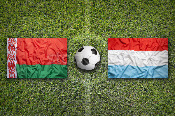 Belarus vs. Luxembourg flags on soccer field Stock photo © kb-photodesign