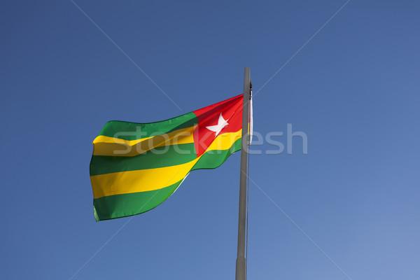 Сток-фото: флаг · флагшток · Blue · Sky · знак · ткань · красный