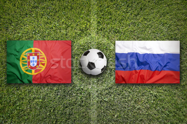 Stock photo: Portugal vs. Russia flags on soccer field