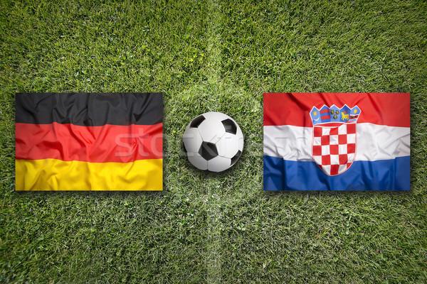 Allemagne vs Croatie drapeaux terrain de football vert Photo stock © kb-photodesign