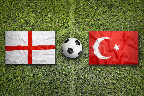 Angleterre vs Turquie drapeaux terrain de football vert Photo stock © kb-photodesign