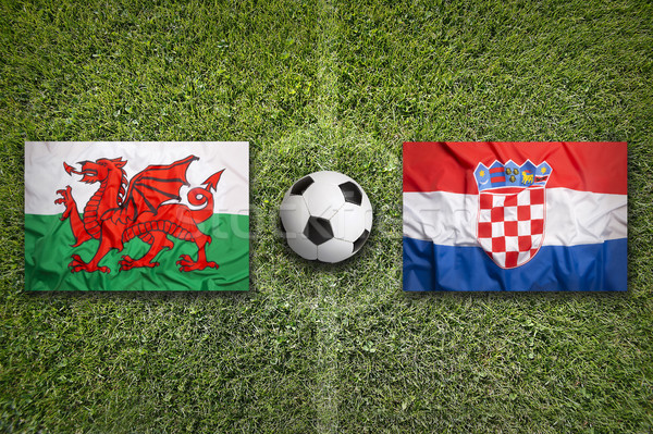 Wales vs. Croatia flags on soccer field Stock photo © kb-photodesign