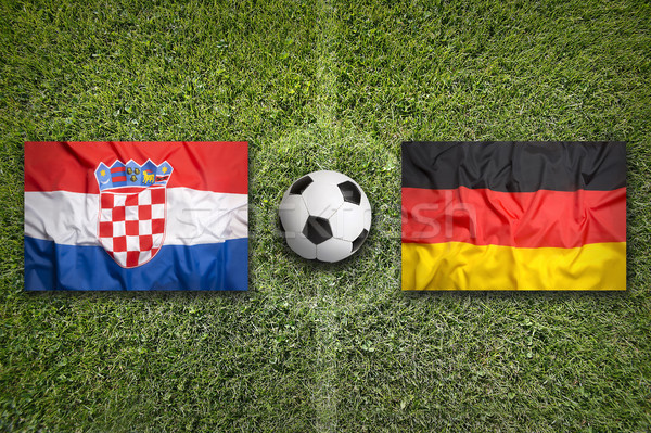 Croatia vs. Germany flags on soccer field Stock photo © kb-photodesign
