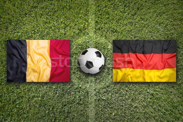 Belgium vs. Germany flags on soccer field Stock photo © kb-photodesign