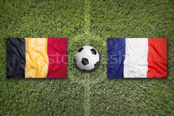 Belgium vs. France flags on soccer field Stock photo © kb-photodesign