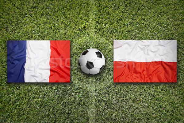Сток-фото: Франция · против · Польша · флагами · футбольное · поле · зеленый
