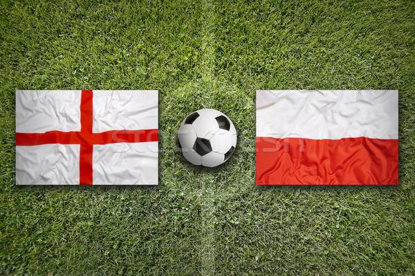 Anglii vs Polska flagi boisko do piłki nożnej zielone Zdjęcia stock © kb-photodesign