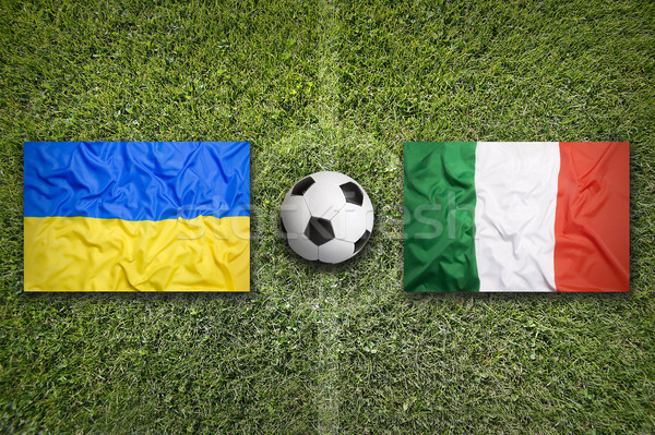 Ukraine vs. Italia flags on soccer field Stock photo © kb-photodesign