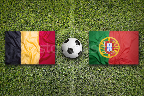 Belgium vs. Portugal flags on soccer field Stock photo © kb-photodesign