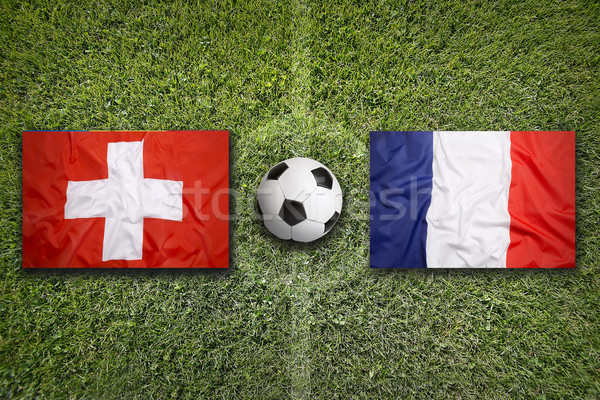 Switzerland vs. France flags on soccer field Stock photo © kb-photodesign