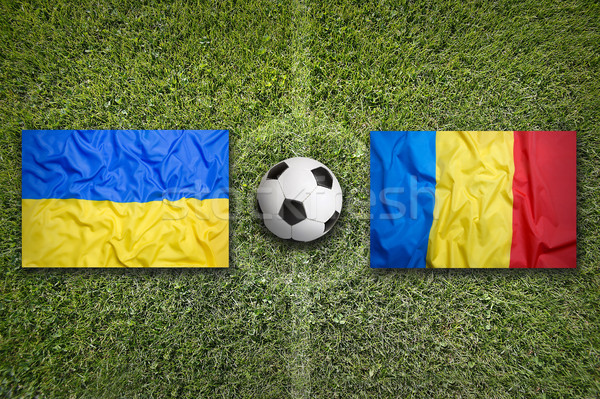 Ukraine vs. Romania flags on soccer field Stock photo © kb-photodesign