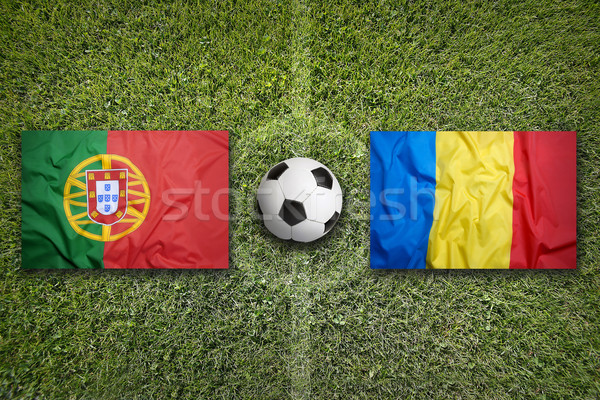 Portugal vs. Romania flags on soccer field Stock photo © kb-photodesign