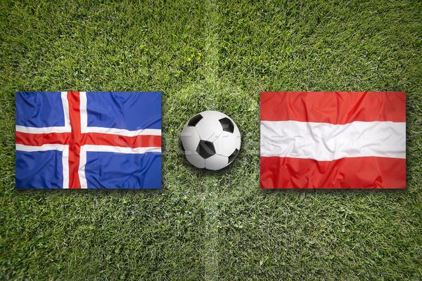 Islândia vs Áustria bandeiras campo de futebol verde Foto stock © kb-photodesign