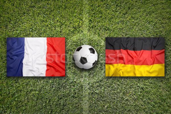Franciaország vs Németország zászlók futballpálya zöld Stock fotó © kb-photodesign