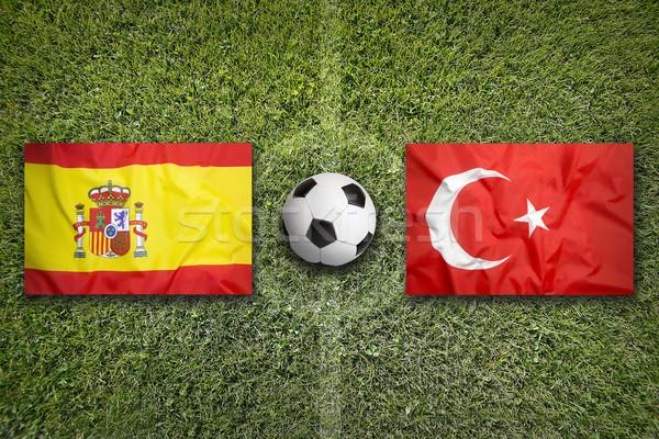 Spain vs. Turkey flags on soccer field Stock photo © kb-photodesign