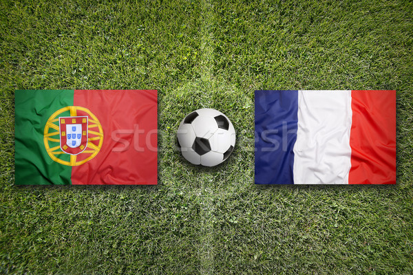Portugal vs. France flags on soccer field Stock photo © kb-photodesign