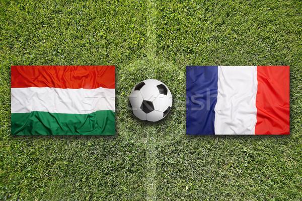 Hungary vs. France flags on soccer field Stock photo © kb-photodesign