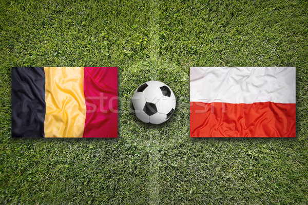 Belgium vs. Poland flags on soccer field Stock photo © kb-photodesign