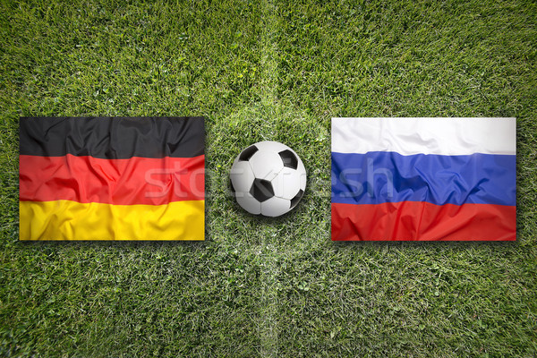 Germany vs. Russia flags on soccer field Stock photo © kb-photodesign