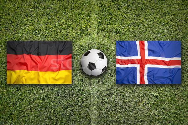Germany vs. Iceland flags on soccer field Stock photo © kb-photodesign