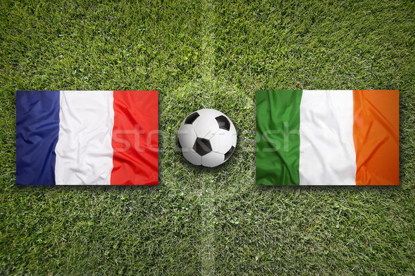 France vs. Ireland flags on soccer field Stock photo © kb-photodesign