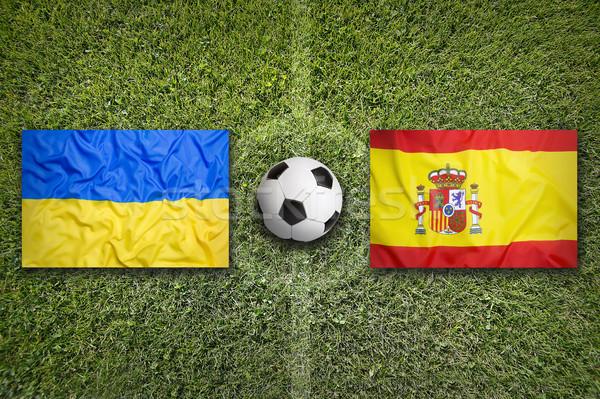 Ukraine vs. Spain flags on soccer field Stock photo © kb-photodesign