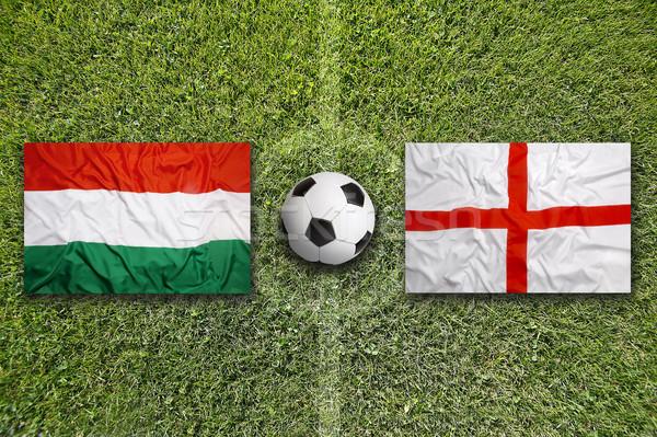 Hungary vs. England flags on soccer field Stock photo © kb-photodesign