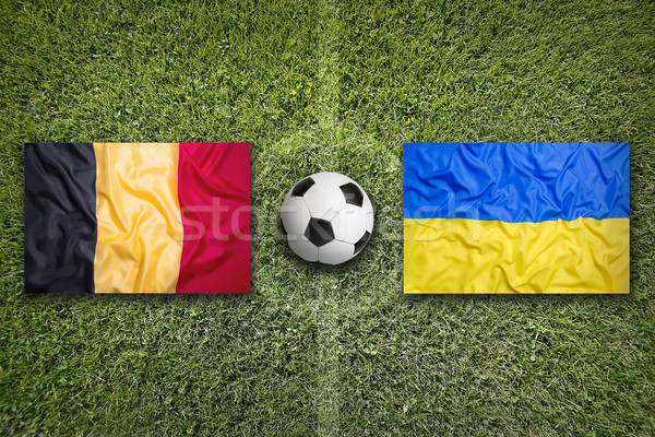 Belgium vs. Ukraine flags on soccer field Stock photo © kb-photodesign