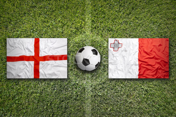 England and Malta flags on soccer field Stock photo © kb-photodesign