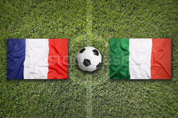 Stock photo: France vs. Italy flags on soccer field