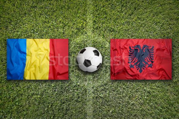 Roemenië vs Albanië vlaggen voetbalveld groene Stockfoto © kb-photodesign